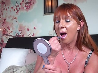 Redhead mature amateur solo model Saskia M. stuffs her pussy with toys