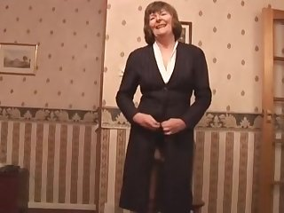 Attractive granny in stockings and girdle shows off hairy pussy