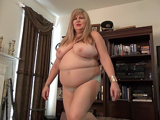 Mature amateur granny Kendal exposses her huge boobs and hairy pussy