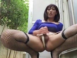 Asian crossdresser cums outside