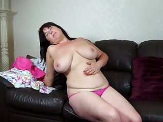 Mature amateur Janey takes off her dress and exposes her hairy pussy