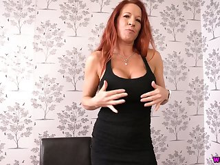 This nasty big breasted redhead with fake boobs loves doing it on her own
