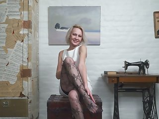 Mature blond housewife in stockings Artemia masturbates shaved pussy