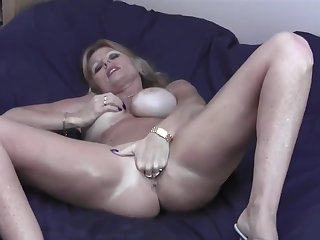 Sexy Big Boobed Milf All Oiled Up On Bed