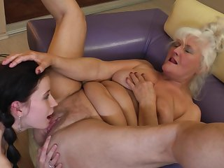 Mature blonde lesbian Isadora seduces a beautiful brunette Juliene