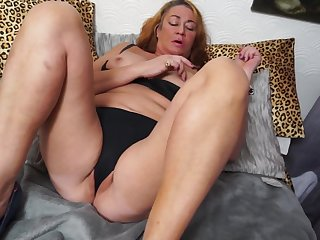 Curly haired mature brunette MILF Bling pounds her pussy with fingers