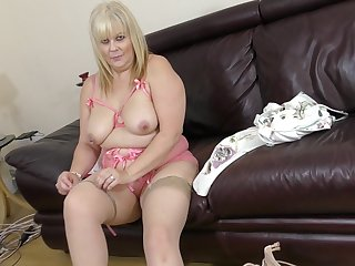 Buxom mature blonde BBW Crystal Maidstone plays with toys in her pussy