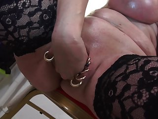 Busty mature blonde MILF Marina Montana plays with her oiled up tits