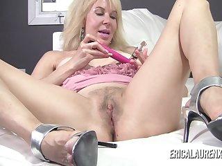 Mature blonde pornstar Erica Lauren puts suction devices on her nipples