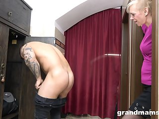mature blonde is on her knees and gives the best blowjob to a stranger
