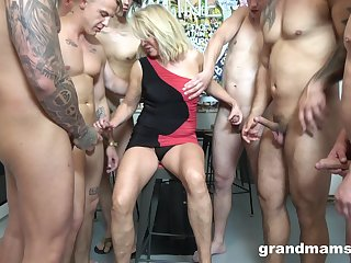 blonde mature adores to suck dicks of young guys before hard gangbang