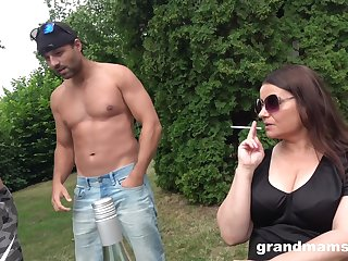 Brunette mature likes to suck two strong peckers at the same time