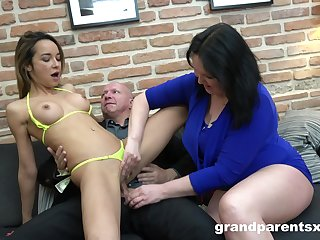 Mature shares her man with the skinny niece in a wild threesome