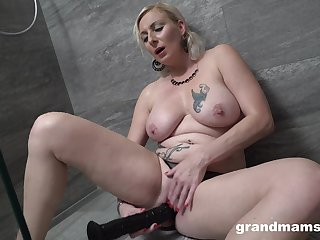 Seductive blonde woman works her new dildo in a sexy solo