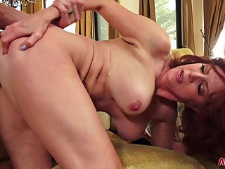 Redhead mature with big tits Andi James in hardcore with cumshot