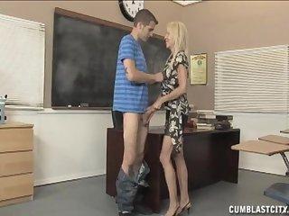 Slutty mature Erica Lauren with fake tits on her knees making him cum