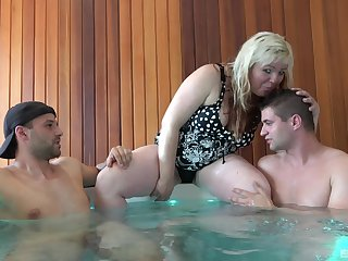 BBW mature amateur Martina pleasures two rock hard dicks in a jacuzzi