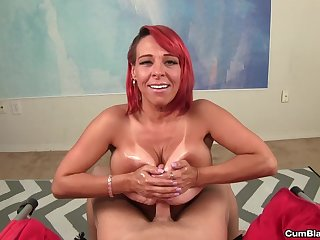 Big tits redhead jerks off a dick and finishes him with a titjob