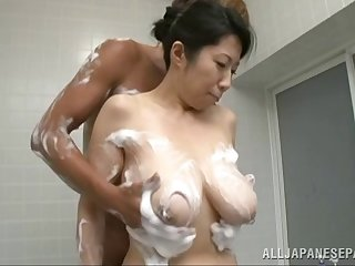 Bosomy and saucy Asian slut gets cum on her tits in this shower scene