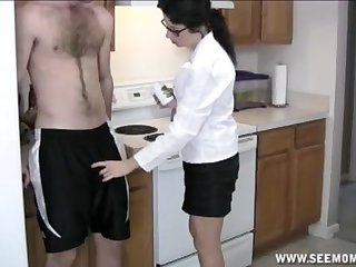 Amateur brunette mature on her knees giving head in the kitchen