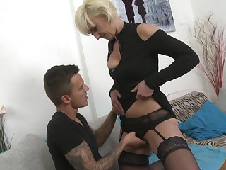 Mature blonde chick Marnie in stockings having sex with her lover