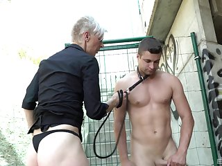 Outdoor fucking with a male slave and a short hair mature amateur