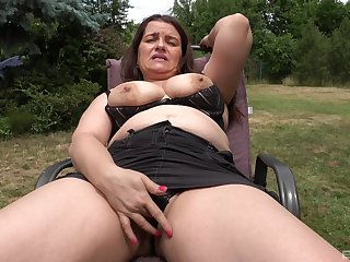 Auntie shows off in the back yard, masturbating like a slut