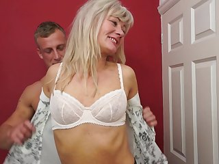 Small boobs mature Ellen B. in socks rides a younger guy's dick