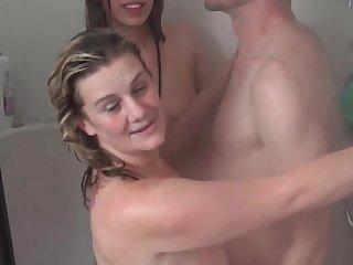 Wet amateur babes sharing stiff cock in shower