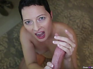 Mature wife with short hair loves to be on her knees giving head