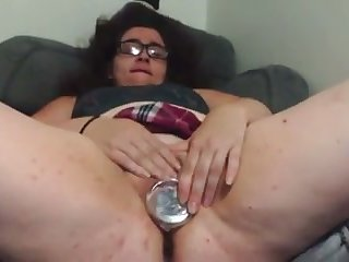 This nerdy coed is a bit on the chubby side and she loves toying her cunt