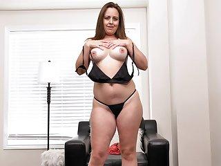 Chubby brunette Brandi Banks drops her thong to masturbate