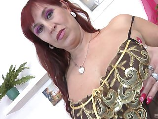 Dude fucks redheaded Darina for all she's worth and makes her nut