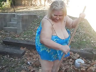 This exhibitionistic granny knows the best way to remove leaves in her yard