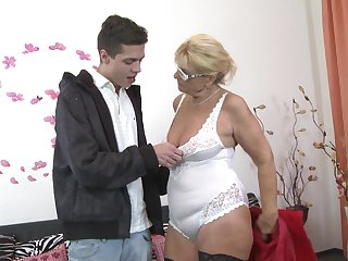Nerdy mature blonde MILF Regina T. sucks and fucks with glasses on