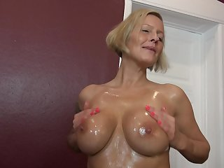 Mature short haired blonde Leni masturbates with a dildo