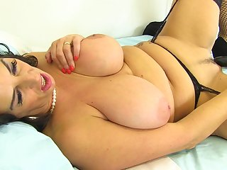 Mega sized boobs and a dildo deep inside the pussy of Lulu