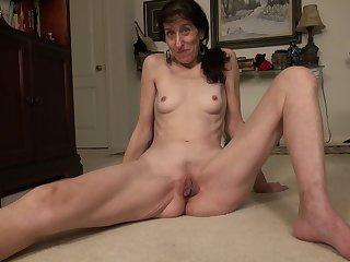 Skinny mature amateur brunette granny Penny J. masturbates with toys