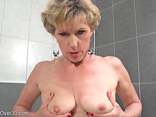 mature in the bathtub - striptease