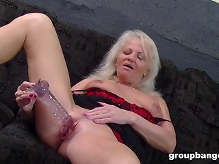 Smiling mature blonde granny plays with toys before riding a fat dick