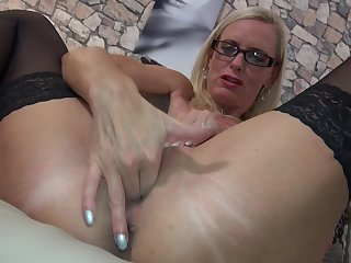 Mature amateur blonde secretary Dirty Tina masturbates with glasses on