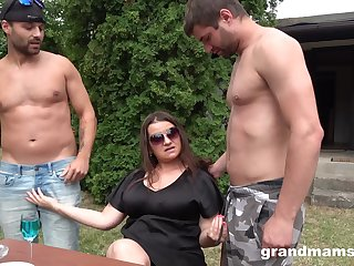 Mature lady adores group sex outside with horny neighbors