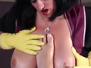 Mature milf plays with cock in the kitchen wearing rubber gloves