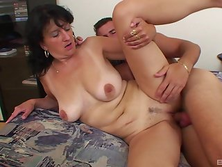 Tanned mature fucked by the nephew and jizzed on pussy