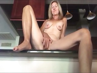 my blonde stepmother orgasms in our kitchen omg