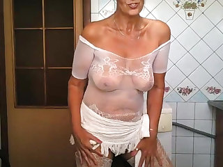 Sexy shorthaired mature mom in glasses wears her sexy white lingerie
